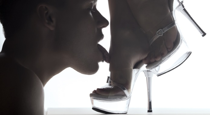 man licking female feet