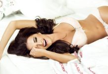 sexy woman smiling on bed