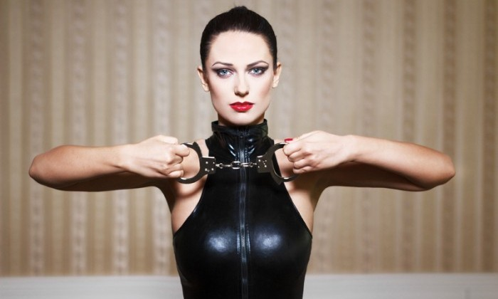 girl in latex with handcuffs