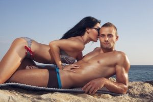Couple Having Quickie On Beach
