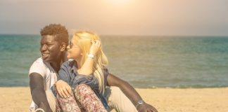 Cute Interracial Couple On Beach
