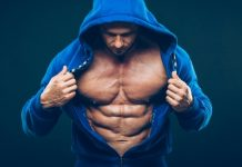 ripped man in blue hood