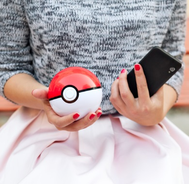woman holding pokeball mobile