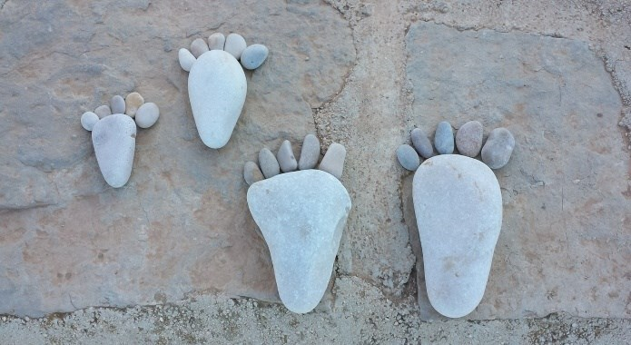 feet totem from pebbles