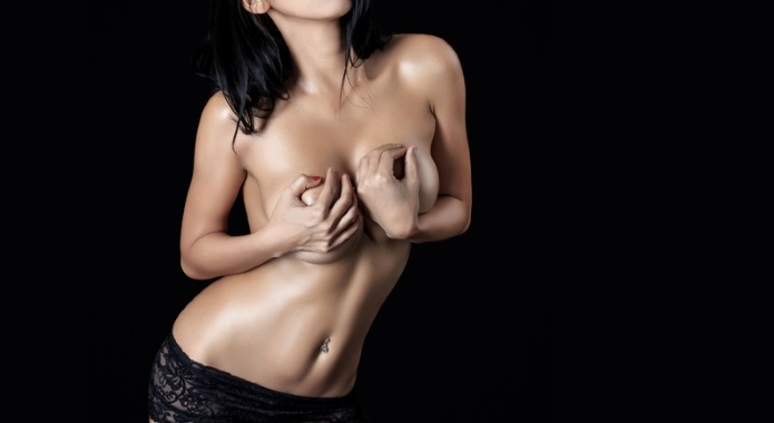 woman cupping her breast