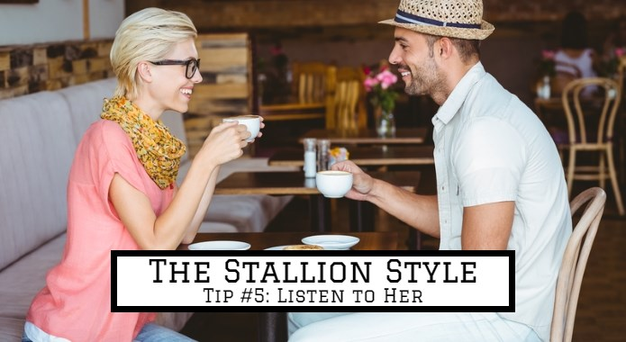 man listening to woman over coffee