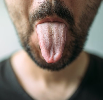 man sticking out tongue mobile