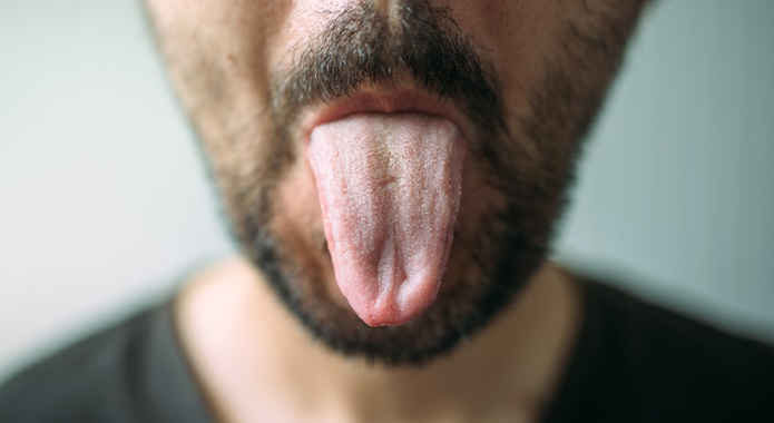 man sticking out tongue